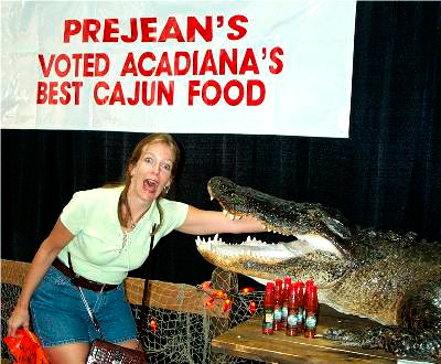 A stuffed alligator guards the door at Prejean�s Restaurant.