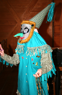 Colorful Cajun Mardi Gras screen mask and costume.